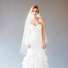 ivory tiered elegant fingertip length tulle wedding veil 1