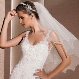 short ivory elbow length veil crafted tulle wedding veil rippled edge 1
